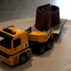 Guggenheim Globetrotters World Tour: Somalia // Toy truck, car and rock // 10 x 29 x 12 inches // 2011