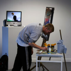 Bi-Location Painting // Live Performance // Stand-in Painter (Stephen Considine), Acrylic on Canvas, Easel, Brushes, Paint Table, Monitor, Amp & Speakers, Skype Connection // Dimensions Variable // 2012
