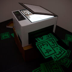 Night Classes in Alchemy // Cardboard, Tape, Perspex, Strobe Light, Photocopies, One Penny Coins // 70 x 40 60 cm // 2009