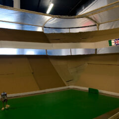 Northern Ireland Peace Proposal / Model No.247: Belfast Celtic Rangers Stadium. Champions League Winners 2015 // Wood, Cardboard, Screws, polyurethane, Spray Paint, Digital print, Flood Lights, Corrugated Plastic // 480 x 440 x 190 cm // 2010