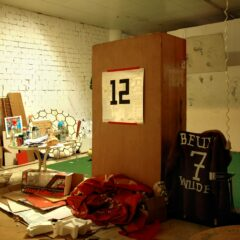 Super Sub Kippenberger and Player-Physic Physio Beuys look at the game from the Sidelines // Found Locker, Metallic Card, Tape, Sheepskin Jacket, Chair // 120 x 200 x 45 cm // 2006