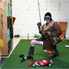 Beuys Jay Walking Classes // Performance // Showing Kindergarten Kids how to jay walk sensibly, using a remote controlled Ferrari and the Joe Beuys Traffic Light Coffee Table // 2006