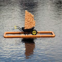 Debt Raft // Sewage Pipe, Pallet, Metal Brackets, Wood, Screws, Glue, Rope, Wheelbarrow, Brick Wallpaper // 350 x 180 x 130 cm // 2008