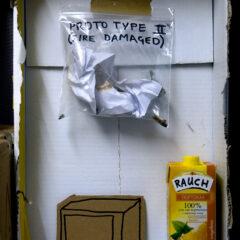 Shrine to Neo Rauch // Cardboard, Tape, Ziplocked Fire Damaged Prototype, Orange Juice Carton, Permanent Marker // 40 x 50 x 25 cm // 2007