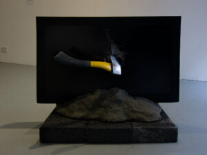 St Brehon's Stone of Inertia // LCD Flat sreen TV, Breeze Blocks, Hatchet, Cement, Sand, Chicken Wire, Pigment, Printed Text & Performance // 250 x 200 x 160 cm // 2015