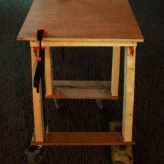 Disenfranchised Coffee Table // Wood, Screws, Bolts, Clamps, Trolley Wheels, Bricks // 120 x 50 x 50 cm // 2006