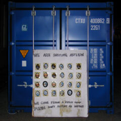Cult Cargo Culture // Shipping Container, Pound Shop Paintings, Wood, Bamboo, Glue, Screws, Bolts, Polyurethane, Tape, Wheels, Acrylic Paint, Permanent Marker // 280 x 240 x 650 cm // 2005