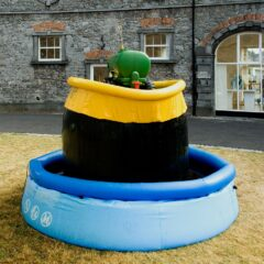 Fountain of Clean Food // Inflatable Pools, Round Hay Bale, Plastic Toy Slurry Spreader, Water Pump, Effluent (Water + Coffee) // 300 x 200 x 300 cm // 2006