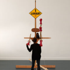 Self-Portrait as a Political Pole // Wood, Electrical Fittings & Light, Screws, Pulleys, Hinges, Cardboard, Soft Toy, Gloves, Plaster, Expandable Foam, Elastic Bungee Cord, Fianna Fáil Election Poster // 220 x 220 x 380 cm // 2005