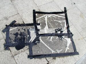 Toxic Culture Disguised as an Oil Spill // Oil,Plastic, Gaffer Tape // 2006