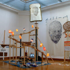 Monument 2 the Sub-Minimum Wage // Wood, Screws, Electric Lights, Bread Wrappers, Car Wiper Motor, Transformer, Brackets, Steels, Wire, Cardboard, Packaging Tape, Acrylic Paint, Sliced Bread & Wrappers // 2005