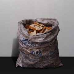 Santa Sacks Africa Claus He Can // Coal Sack, Acrylic Paint, Toast // 80 x 40 x 35 cm // 2005