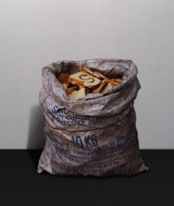 Santa Sacks Africa Claus He Can // Coal Sack, Acrylic Paint, Toast // 80 x 40 x 35 cm // 2005