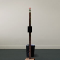 The Jimmy Durham Spilt Milk Fountain: Deluxe Version // Wood, Screen, Printed Text, Metal Brackets, Bin, Water Pump, Hosing, Water, Paint, Milk Carton // 250 x 200 x 90 cm // 2005